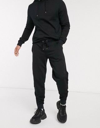 ASOS DESIGN tracksuit with hoodie & sweatpants with silver zip in black