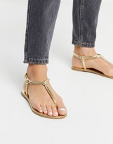 Qupid thong flat sandals in gold