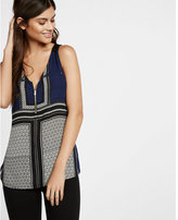 Express placed print zip front tank