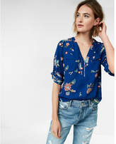 Express floral long sleeve zip front blouse