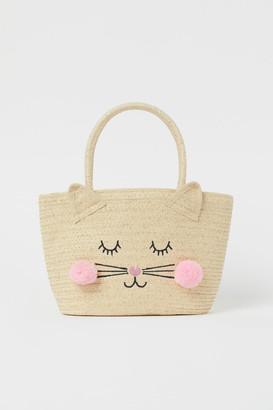 H&M Appliqued straw bag