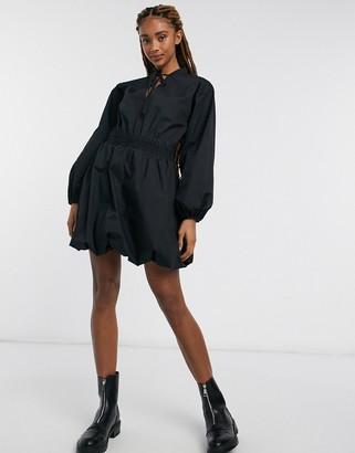 ASOS DESIGN cotton poplin bubble hem mini dress with shirred waist in black
