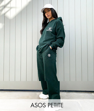 ASOS DESIGN Petite tracksuit oversized hoodie / straight leg jogger with take care embroidery in dark green