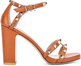 Valentino Rockstud Ankle Strap Sandals in Selleria | FWRD