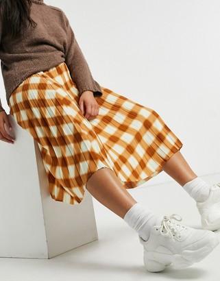 Monki Yan check pleated midi skirt in brown