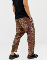 Asos Design DESIGN oversized tapered trousers in leopard print with side tape
