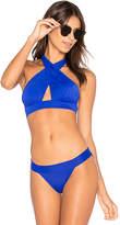Norma Kamali Cross Halter Bikini Top in Blue. - size L (also in M)