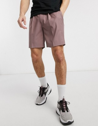 ASOS DESIGN tapered smart shorts in pink with pleats