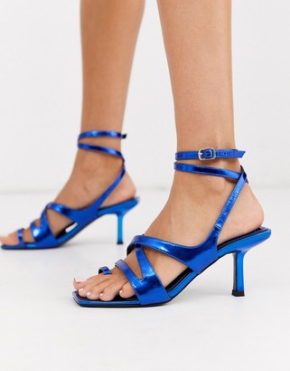 ASOS DESIGN Harley strappy toe loop mid-heeled sandals in blue metallic