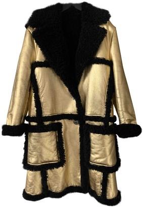 Prada Gold Shearling Coats