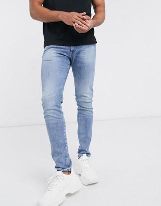 Edwin ED85 skinny fit jeans in washed blue denim