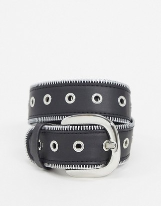 ASOS DESIGN silver zip edge waist and hip jeans belt with eyelet detail in black