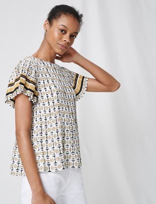 Maje Pleated tunic with preppy print