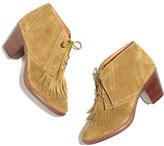 The sandstorm fringe boot