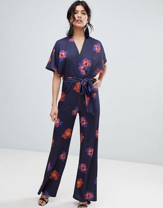 True Violet floral flutter sleeve jumpsuit