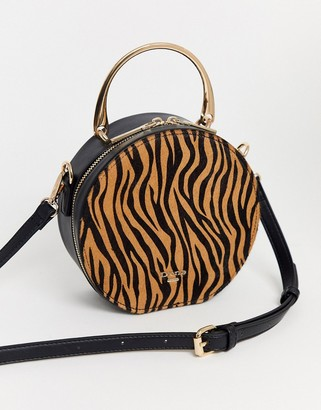 Dune round shoulder bag in black with handheld detail
