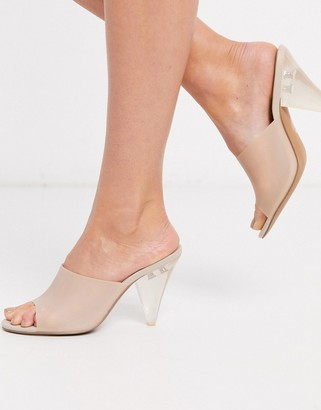 Asos DESIGN Notify heeled mules in sand