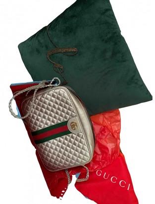 Gucci Laminated Metallic Leather Handbags