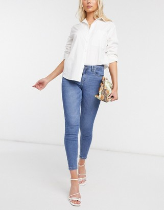 Only midrise ankle grazer skinny jeans in light blue wash