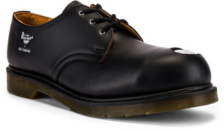 Raf Simons x Dr. Martens Asymmetric Cut Out Steel Shoe in Black | FWRD
