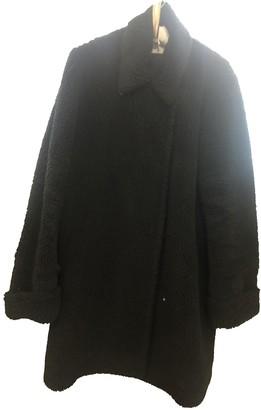 Maison Margiela Black Faux fur Coats