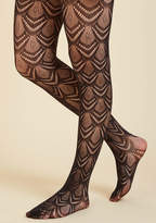 1127 Stir up an already stylish situation by tossing these sheer black tights in the mix! With a fan-like pattern that conjures up art deco images, this celebrity pair completely exhilarates everyone who 'embers' the vicinity.