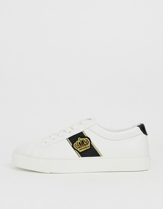 ASOS DESIGN trainers in white with crown badge embroidery