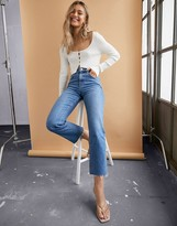 Asos Design DESIGN High rise 'effortless' stretch kick flare jeans in mid vintage wash