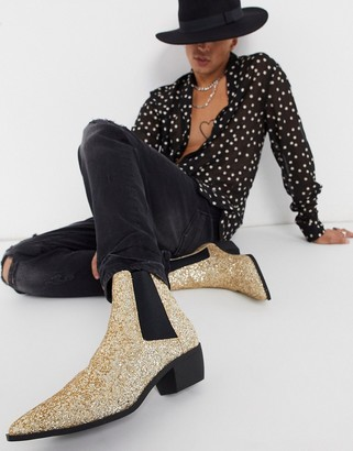 ASOS DESIGN stacked heel western chelsea boots in gold glitter with metal hardware