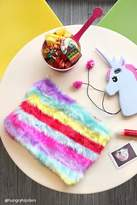 Forever 21 FOREVER 21+ Faux Fur Striped Rainbow Clutch