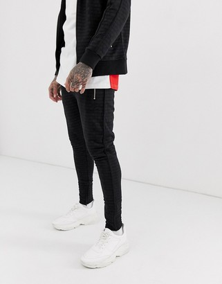 Couture The Club Club allover print tracksuit bottoms-Black