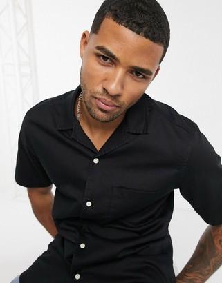 ASOS DESIGN stretch slim organic short sleeve denim shirt with revere collar in black