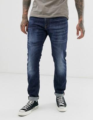 Diesel Thommer stretch slim fit jeans in 083AU mid wash