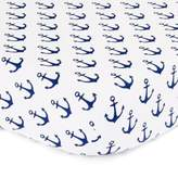 The Peanut Shell Anchor Fitted Crib Sheet in White/Navy