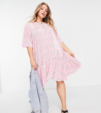 ASOS DESIGN Curve plisse mini dress with dip hem in pink floral print