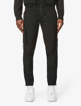 Trapstar Utility branded relaxed-fit shell jogging bottoms