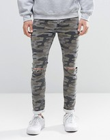 Asos Super Skinny Jeans With Knee Rips In Camo
