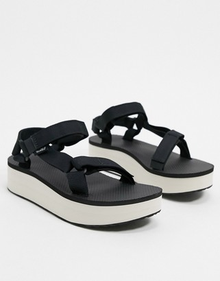 Teva flatform universal sandals in black and tan