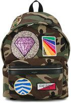Saint Laurent multi-patch City backpack - men - Cotton/Leather - One Size