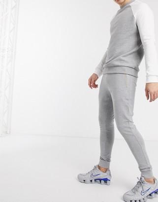 ASOS DESIGN organic super skinny sweatpants in gray marl with gold zip pockets