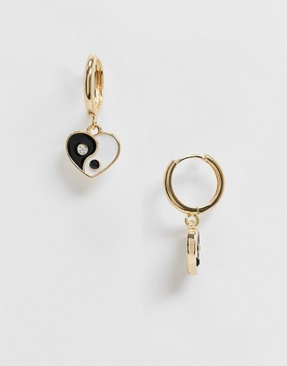 ASOS DESIGN hoop earrings with ying yang heart charm in gold tone