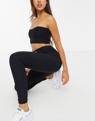 Reebok small logo fleece leggings in black