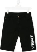 Versace logo print denim shorts