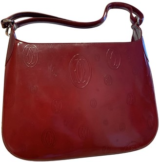 Cartier Burgundy Patent leather Clutch bags