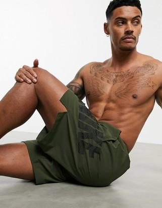 Nike Training Flex shorts with camo logo in khaki