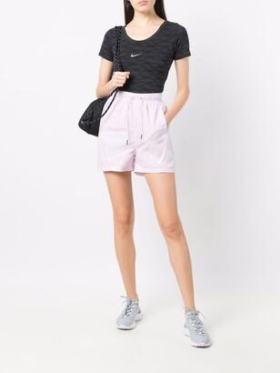 Nike Swoosh print shorts