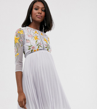 Asos DESIGN Maternity mini dress with pleat skirt and lace inserts in floral embroidery
