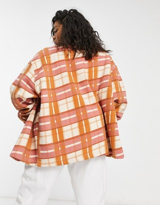 Lasula Plus oversized check shirt in orange