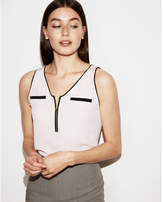 Express piped zip front tank