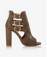 Express platform heeled buckle sandal